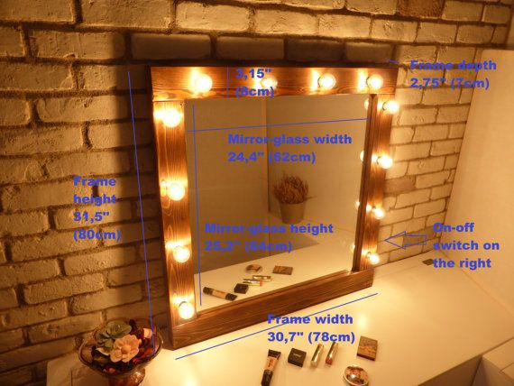 Handmade rustic makeup mirror with lights in a dark walnut stain with lights for every makeup addict! Perfect for rustic or industrial decoration! Light it up and treat yourself to a professional makeup experience!  SIZE ► 31,5 tall x 30,7 wide x 2,75 deep (80x78x7cm) ►► PLEASE READ ◄◄ BULBS-VOLTAGE-POWER OUTLETS-PLUG ►AMERICAN CUSTOMERS will receive their mirror with sockets for E12 (candelabra) base sockets / US type plug ►UK CUSTOMERS will receive their mirror with sockets for E14 bas...