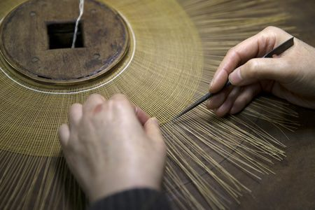 """The process of making the brim of a """"gat"""" or Korean traditional hat with bamboo threads."""