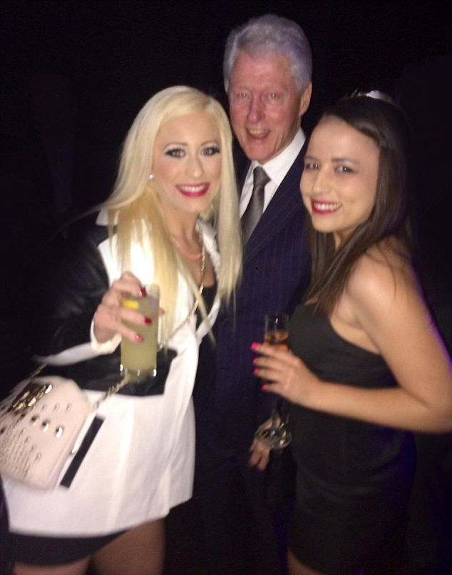 Former President Bill Clinton posed for a photo at an event Thursday night with two women who work as legal prostitutes at the Moonlite Bunny Ranch in Nevada. Description from midufinga.net. I searched for this on bing.com/images