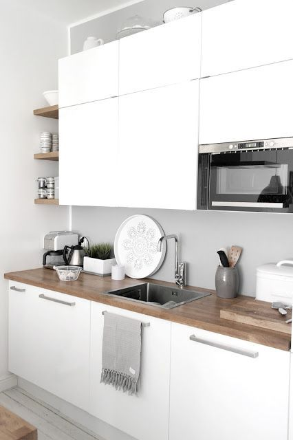 White little kitchen. Love the timber benchtop