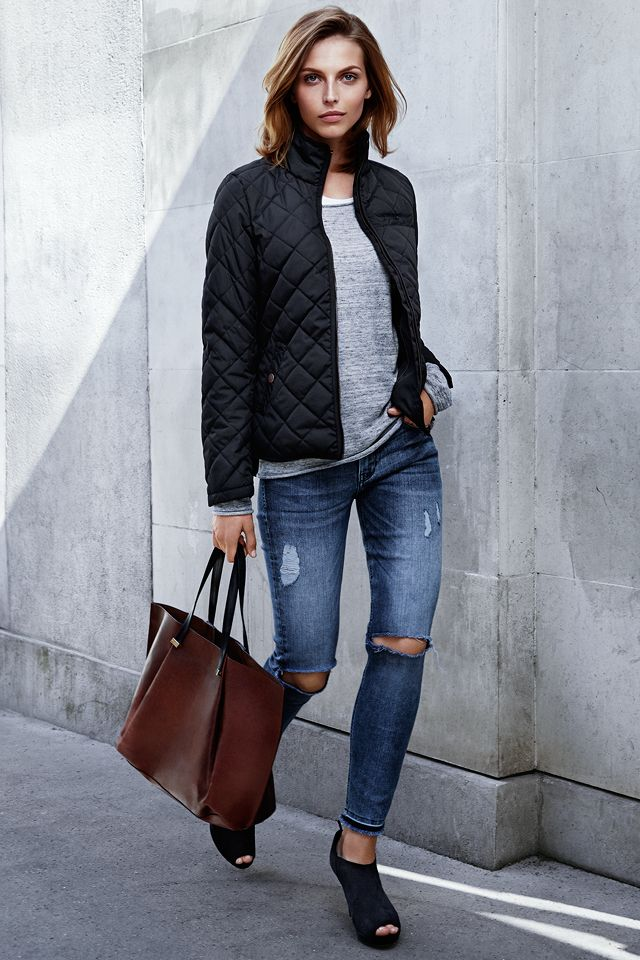 Black quilted jacket with smartphone pocket. #WARMINHM