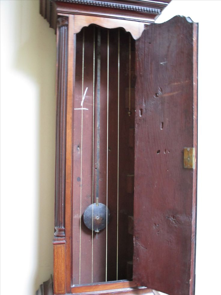 Detail of pendulum from the mahogany longcase clock located on the Eisenhower Gallery, Culzean Castle. Mid-18th century, Channel Islands.