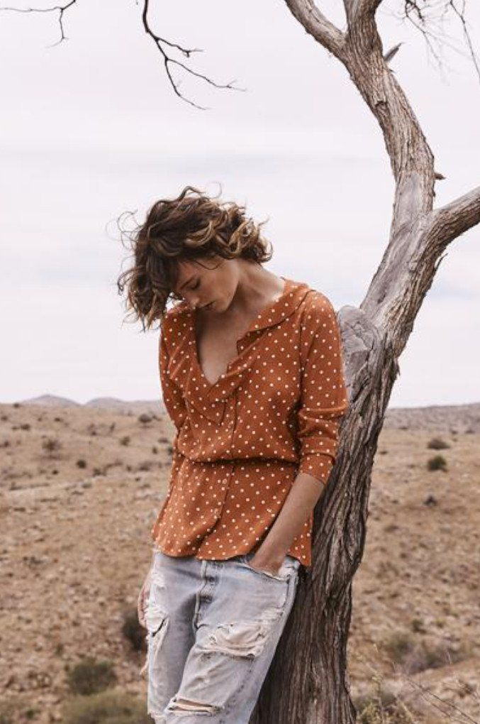 The Lilly Shirtin a sweet, Classic Polka Dot print, with a button up front, adefined waist that gives this piece a vintage feel, and three-quarter sleeves that are perfect for the cooler months.