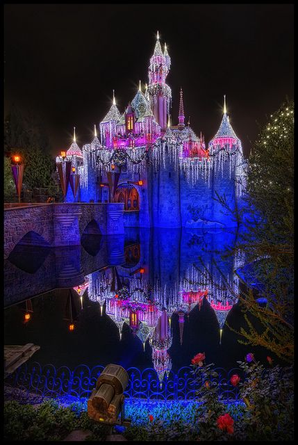 sleeping beauty castle, at disneyland, all lit up at christmas time
