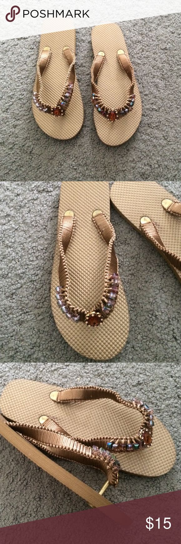 Hand Decorated Flip Flops Gold flip flops decorated with gold nylon cord and pretty matching beads. Brand new. Never worn. Shoes Sandals