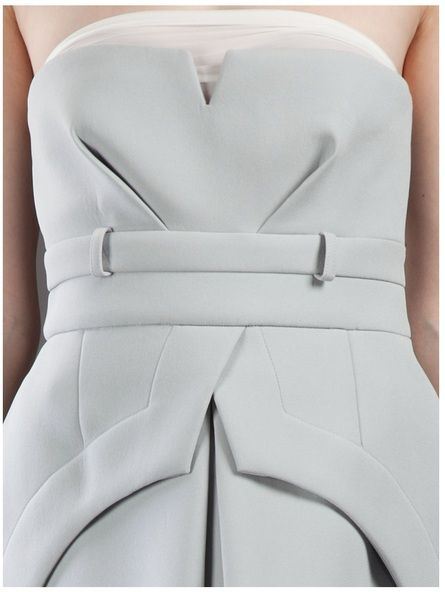 "Structured fashion. Pinned for the simplistic shape, fitted closely to the body (see ""key"" definition)."