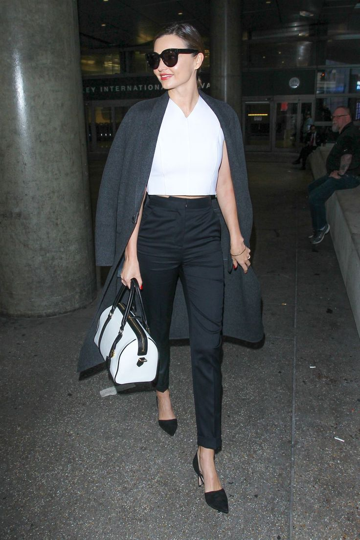 MIRANDA KERR at LAX Airport in Los Angeles 04/13/2016