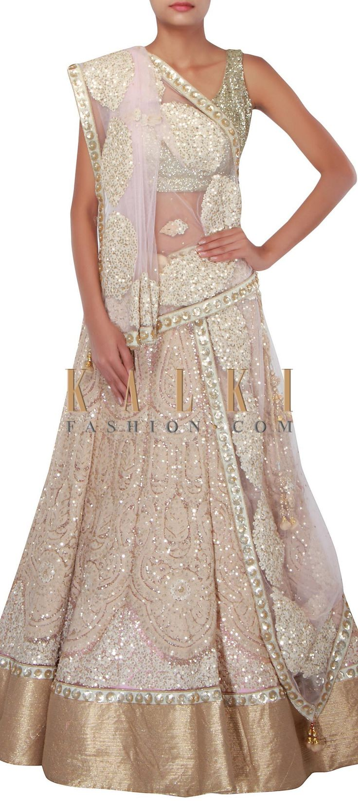 Buy Online from the link below. We ship worldwide (Free Shipping over US$100) http://www.kalkifashion.com/light-beige-lehenga-features-with-embossed-thread-embroidery-only-on-kalki.html