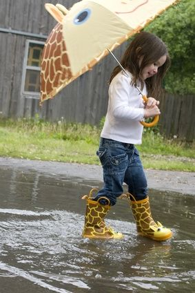 I'm tottaly a fan of rain boots.. And her boots are cute with her umbrella.. She has a kickass look!