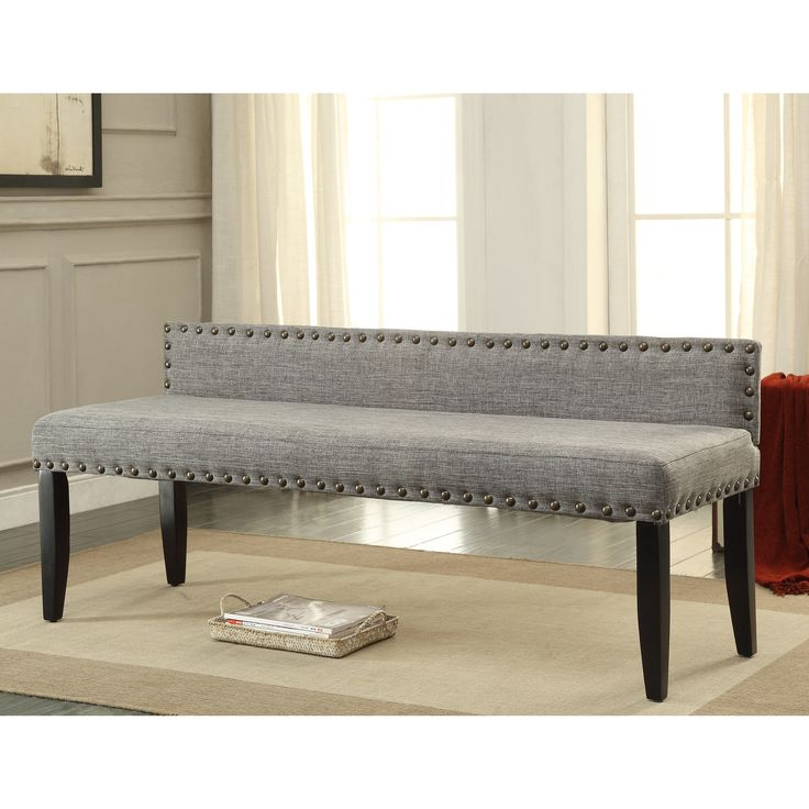 This stylish bench is constructed from padded flax fabric for an urban, earthy appeal. Designed with a simplsitic shape, this bench offers detailed and bold nailhead trim accents that emphasize the slim yet wide back.
