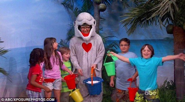 Joking around: Gary Oldman assumed the moniker Danny The Dolphin and held out a bucket of marshmallows while taking part in the bizarre Vale...