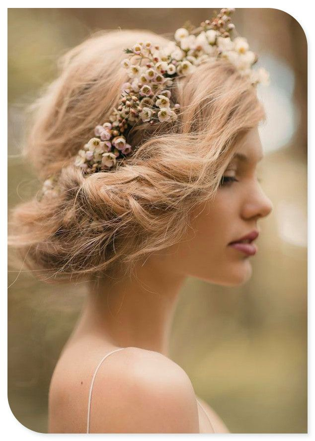 This messy up do complete with floral garland is the perfect look for any spring/summer bride. #bridestheshow