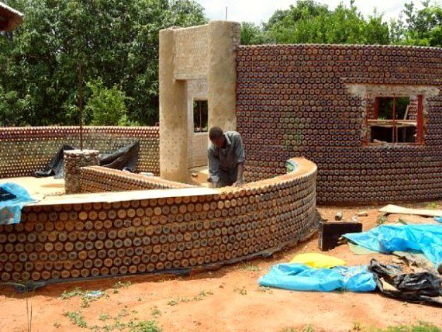 Make your own custom bullet proof, fireproof & earthquake resistant buildings with 100% recycled materials! The walls are made from used plastic bottles, filled with sand and coated with a moderate amount of mud and cement to smooth the wall and make it appealing.