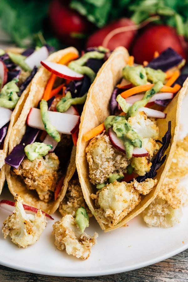 Crunchy Cauliflower Tacos w/ Avocado Lime Sauce   via veggiechick.com #vegan #glutenfree