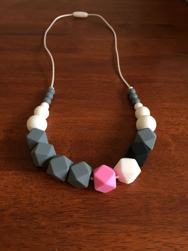 Silicone Teething Necklace- Fussy Little Fox Hexagon Teething Necklace in grey, pink, white and black on silver nylon cord with silver safety catch. $30 + Free Shipping within Australia. Visit Fussy Little Fox on Facebook to see more or email fussylittlefox@gmail.com to purchase.