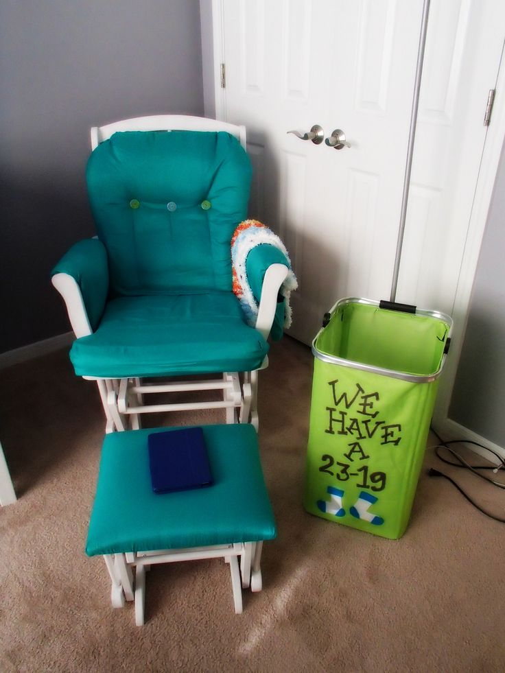 "My Monsters Inc Nursery - Spray painted and reupholstered glider with ""We have a 23-19"" laundry bin. I bought the bin at Target, added felt socks and used purple sharpie for the writing."