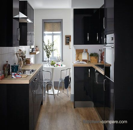 B&Q - IT Santini Gloss Black Slab. A bold and edgy shade, the Santini Gloss Black Slab kitchen is a contemporary look instantly creating personality to your kitchen. Find out more here - http://bit.ly/1RR4ZQH