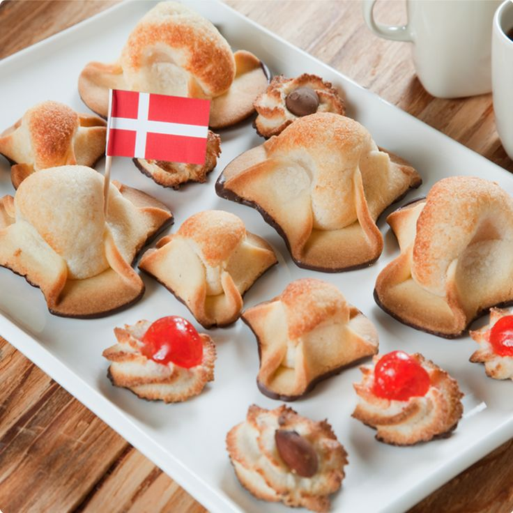 The big ones are called Napoleon Hats and the smaller ones are a variation of 'kransekage', I believe. (The Danish Pastry House - Authentic Danish Pastries in Toronto)