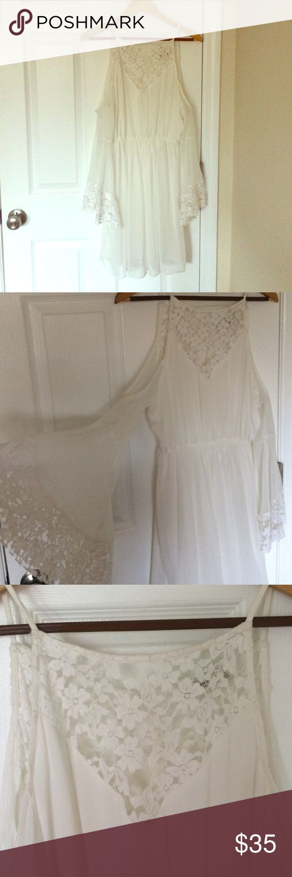 Abercrombie and Fitch white lace dress Short white chiffon with lace dress from Abercrombie and Fitch. Has some lace detail on the chest and sleeves. Sleeves are open shoulder and wide at the ends. Worn once. Abercrombie & Fitch Dresses Mini