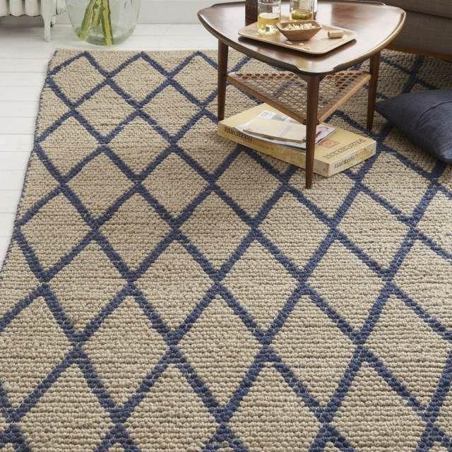 tapis noué et élégant en laine à motifs géométriques bleus