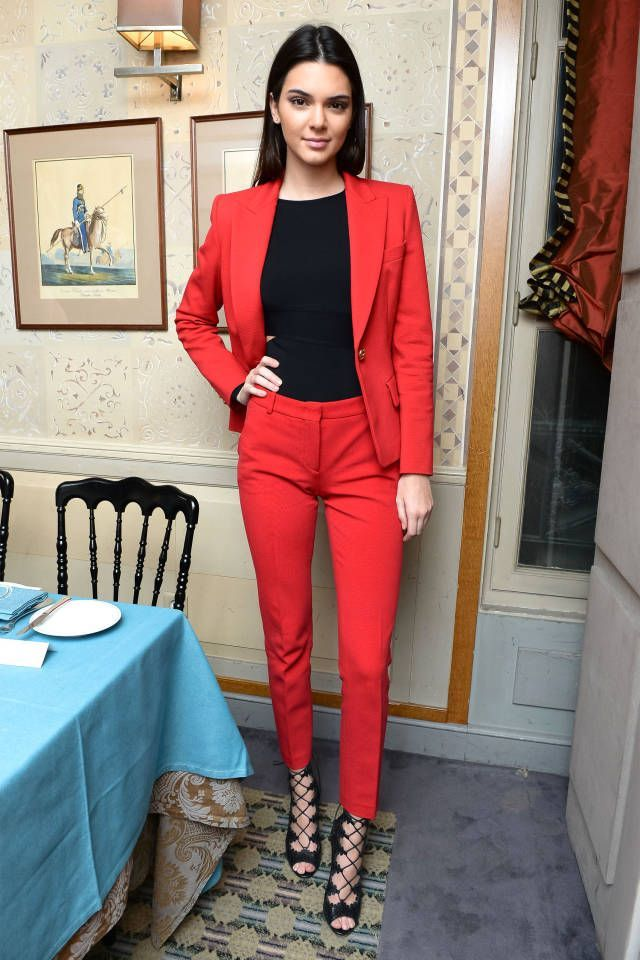 Shop this look on Lookastic:  http://lookastic.com/women/looks/red-blazer-black-tank-black-heeled-sandals-red-dress-pants/8474  — Red Blazer  — Black Tank  — Black Leather Heeled Sandals  — Red Dress Pants