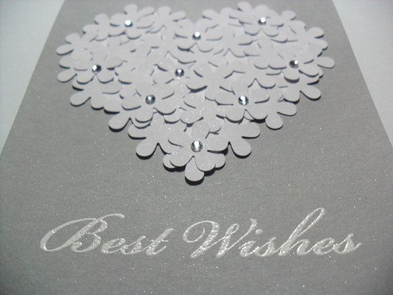This card is sold out on etsy, but it is still gorgeous.   This pretty card is perfect for engagements, bridal showers, and weddings!    Features:  -Each flower is hand punched and arranged into the shape of