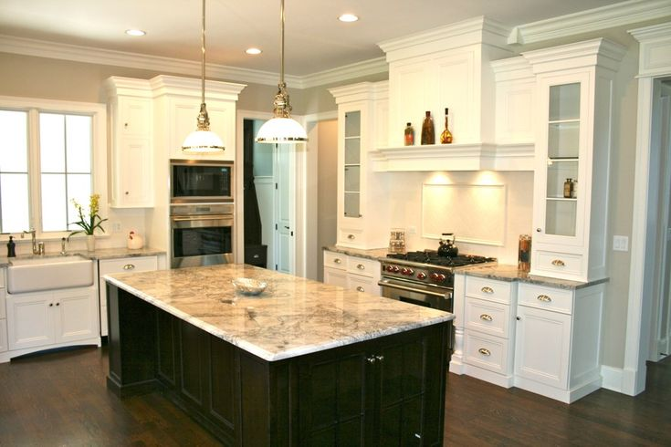 love the white cabinets dark island kitchen design