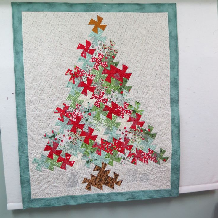 Twister ruler used. Ornaments on the tree and the border were quilted in the hoop the rest was free motion.