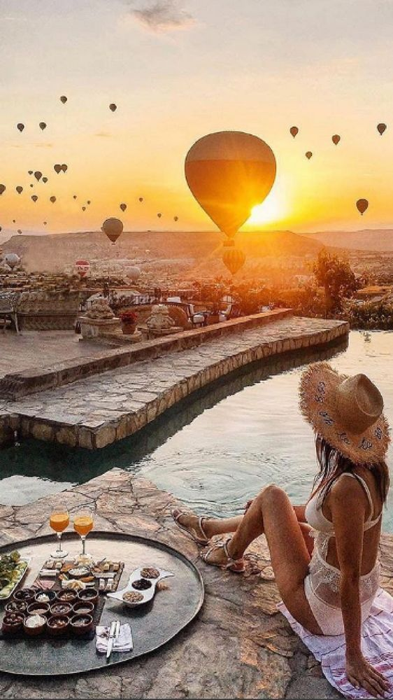 Sunrise with hot air balloons - view from the terrace pool in Museum hotel, Cappadocia - by @museumhotel via Instagram. 10 Beautiful spots in Cappadocia that are Instagram worthy.