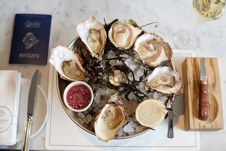 Bentley's, on Swallow Street, has been serving world-renowned oysters over its opulent marble bar for the past ten decades. Opening in 1916 and owned by Michelin starred chef Richard Corrigan, this luxurious yet laid-back seafood spot is steeped in history – having begun serving oysters before your even your Grandpa was born.