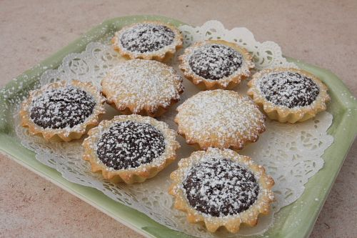 Bocconotti after baking dusted with powder sugar