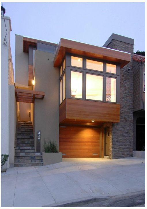 Modern cedar garage door. Cool rectangular bay window structure.