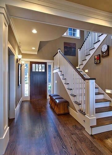 Oak floors with dark walnut stain against simple white trim, love the wall color (painted bead board)--The paint color is Sherwin Williams Sand Beach Flat Oh this is lovely
