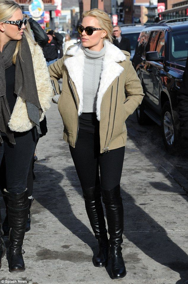 Walking through Utah: Margot Robbie, The Wolf of Wall Street beauty looked glamorous and chic in a #sheepskin coat on top of a grey jumper