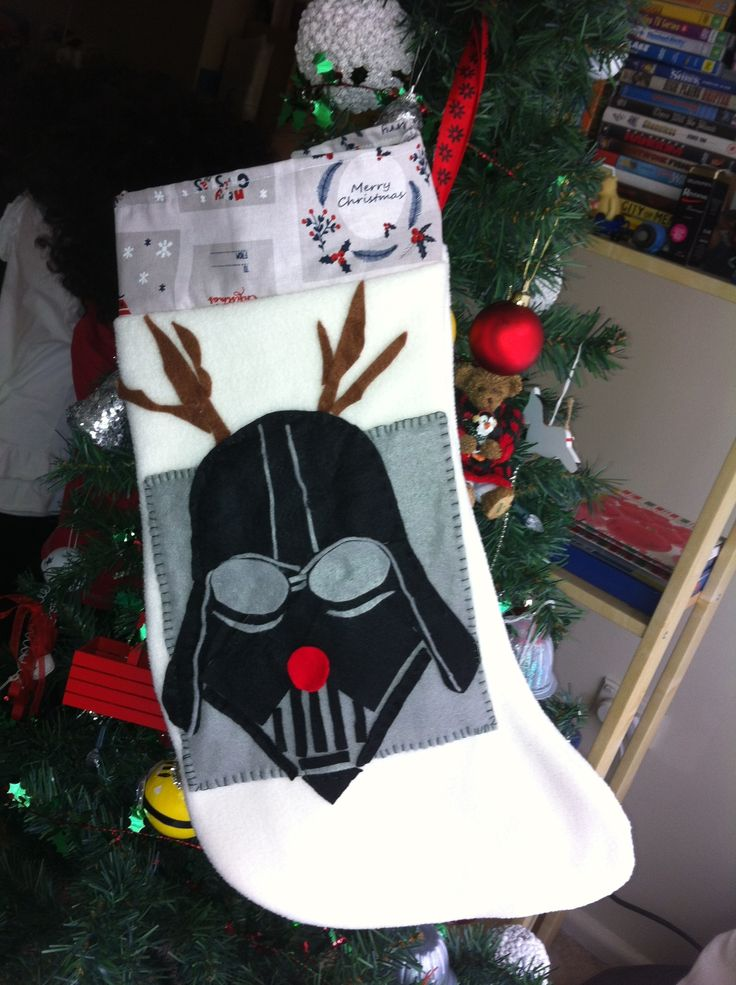 Star wars Darth Vader Christmas stocking Made from fleece, calico as the inside lining and felt for the Dart Wader character No stencils used just scissors on felt. FB- creativity at its best