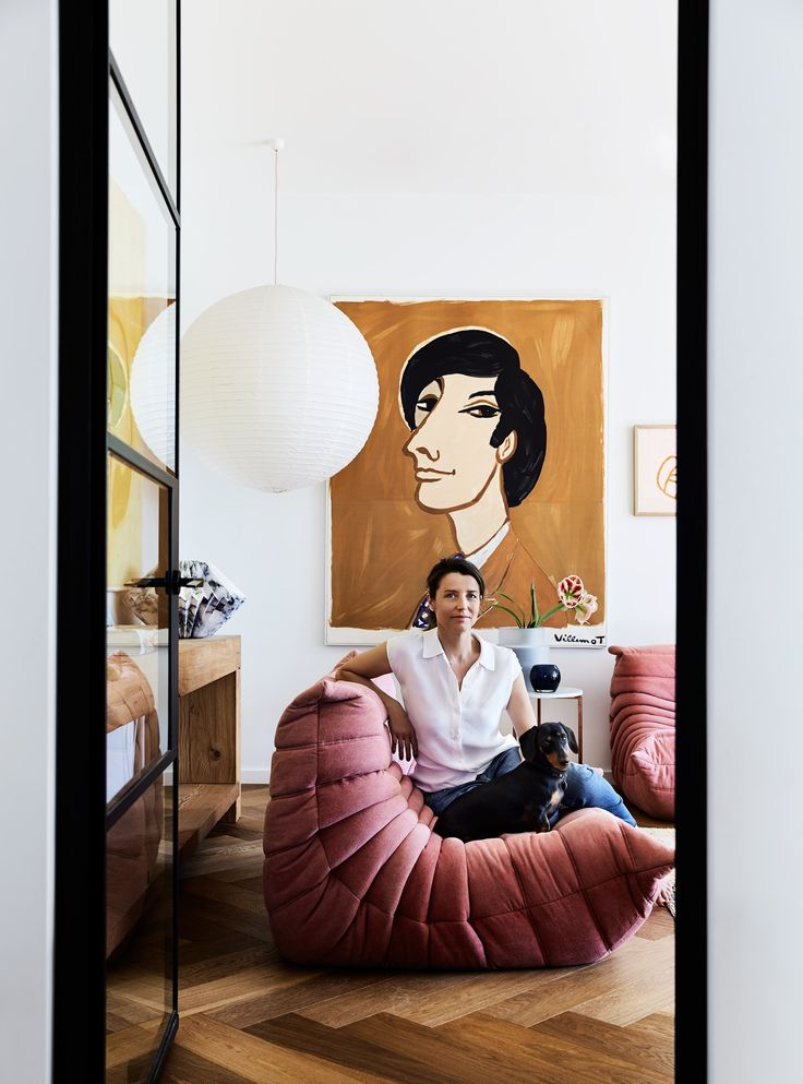 "Rachel cuddles up with Sydney Sausage on her [Ligne Roset](https://www.ligne-roset.com/au/) ""Togo"" sofa. A large paper shade lights up an or..."