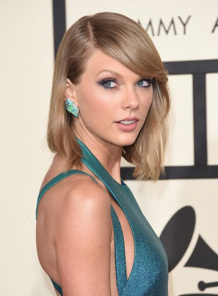 Taylor Swift Photos Photos - Singer Taylor Swift attends The 57th Annual GRAMMY Awards at the STAPLES Center on February 8, 2015 in Los Angeles, California. - 57th GRAMMY Awards - Arrivals