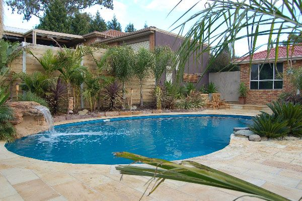Cascade pool water feature on a classic kidney pool design by Albatross Pools