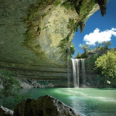 Hamilton Pool Preserve, Austin, Texas  in the United States.    A naturally collapsed grotto became a cool and serene recreational pool for the people of Austin Texas.