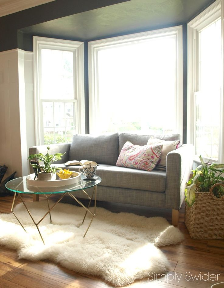 Turn a bay window into a reading nook livingrooms in - Bay window ideas living room ...