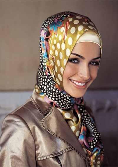 Beautiful Muslim woman wearin' hijab or scarf