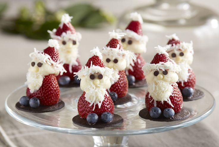 Strawberry Santas - It doesn't get much sweeter than these adorable strawberry Santas made with cream cheese frosting. They're sure to put a smile on everyone's face (young and old) this holiday season. Ho Ho Ho!