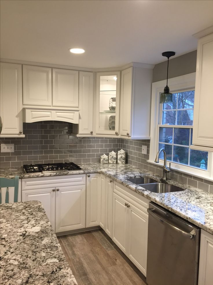 Stunning remodeled kitchen using Ice Gray Glass Subway Tile backsplash. https://www.subwaytileoutlet.com/products/Ice-Glass-Subway-Tile.html#.WHUueFMrKUk