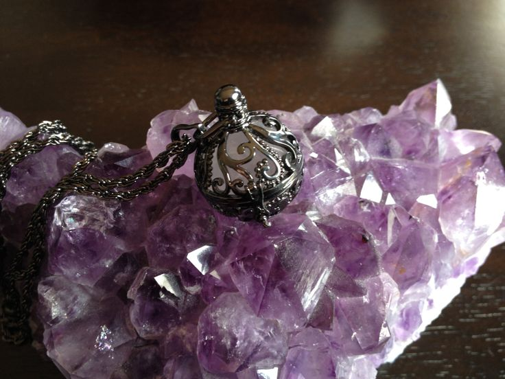 Gunmetal locket with rose quartz by wellbeingbliss on Etsy