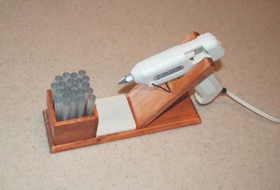 glue gun holder.  i can't think of a more perfect idea!  mine is always flipping over and getting glue all over the place!