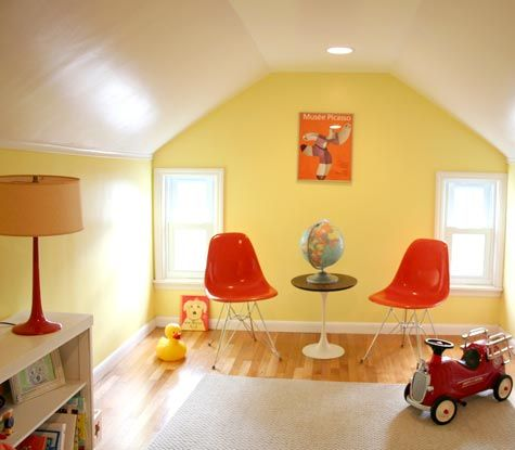 This looks almost too perfect to be a real playroom, but I love it anyway. Eames, classic, mid-century, red and yellow.