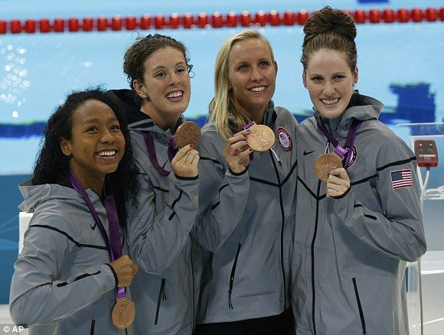 (Left to right) Lia Neal, Allison Schmitt, Jessica Hardy and Missy Franklin pose with their bronze medals in the women's 4x100-meter freestyle relay swimming final. July 28, 2012. .....Olympics- London, England