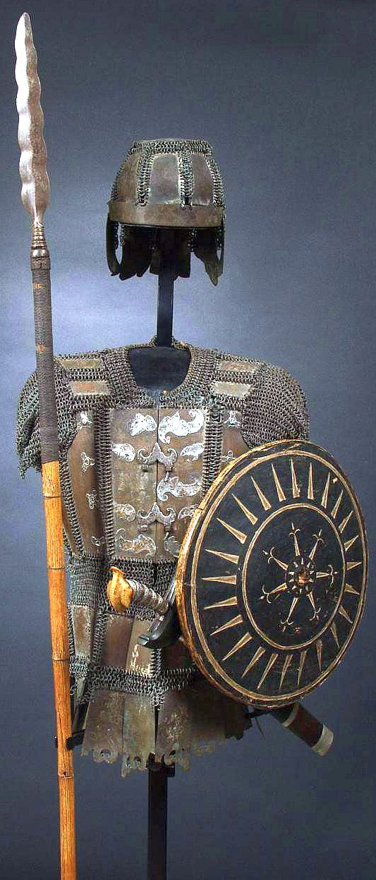 """Philippine armor, the Moro wore hide armor, or jackets of heavy cord, or covered with scales of bark. Those who could afford a better equipment wore armor of brass, or horn, plates connected by heavy brass mail of peculiar design, probably copied from Spanish models. The helmets were generally of brass shaped like the 17th-century Spanish casques.  Occasionally they were made of plates of horn connected by mail like the hauberks, or entirely of horn."""""""