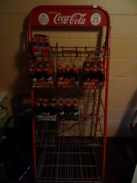 Vintage Coca Cola Retail store rack. Includes 5 cases of full bottles. 2 cases of empty bottles. 29 x 21 x 63