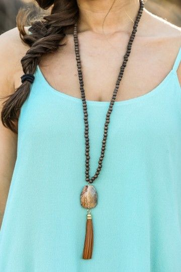 The perfect necklace to complete your favorite Spring outfits! Gorgeous, natural stone with tassel detail and beaded chain!
